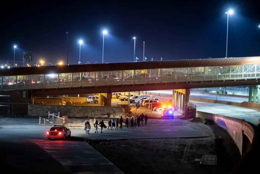 U.S. Customs and Border Protection agents escorted a group of migrants near the Paso del Norte International Bridge in El Paso in 2019.