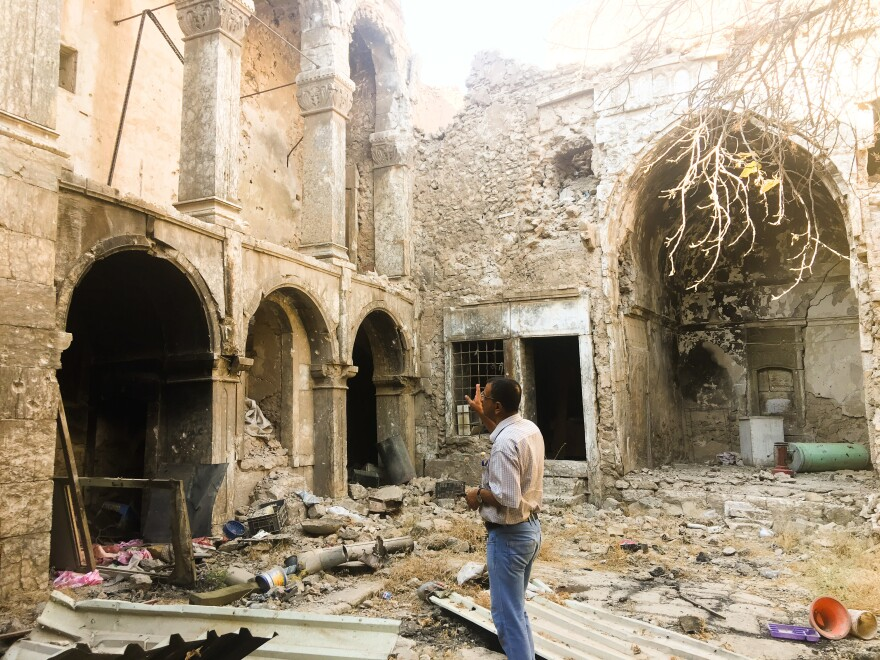 A Mosul resident looks at the ruins of a damaged historic house in his neighborhood in Mosul's Old City. The United Nations estimates 8,000 homes were damaged or destroyed in the fighting to take back this section of Iraq's second-biggest city.