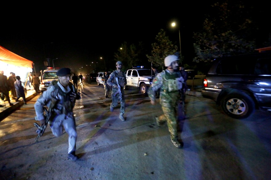 """Afghan security forces rush to respond to an attack on the campus of American University of Kabul on Wednesday. """"We are trying to assess the situation,"""" President Mark English told The Associated Press."""