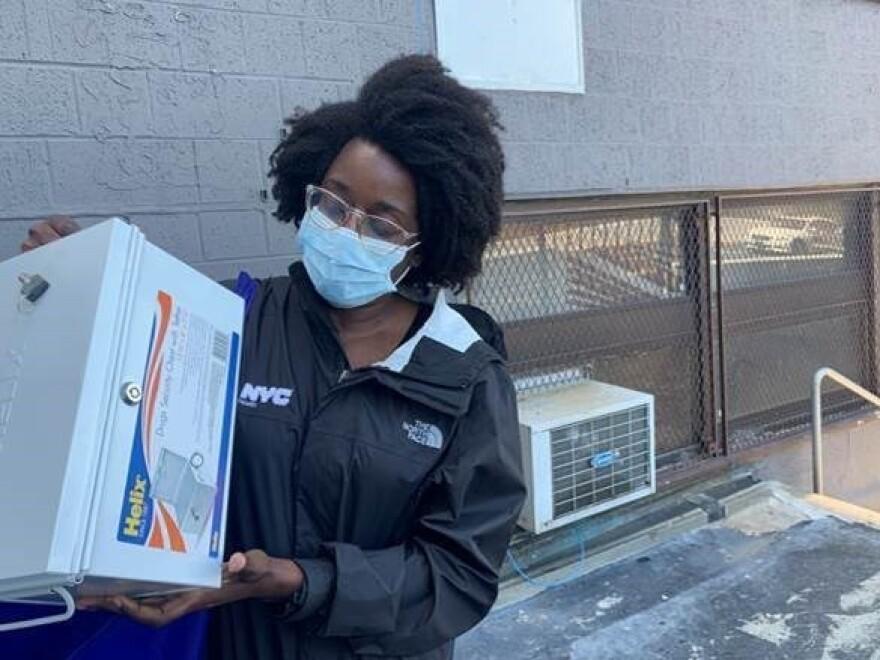 NYC Health Department field responder Renée Nicolas prepares a medicine lock box for a methadone delivery in Far Rockaway, Queens, New York last Friday.