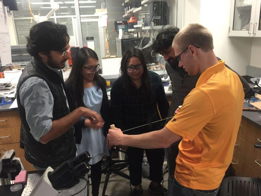 The paperfuge team works on the newest prototype. They include (from left) Saad Bhamla, Aanchal Johri, Chew Chai, Manu Prakash and Brandon Benson.