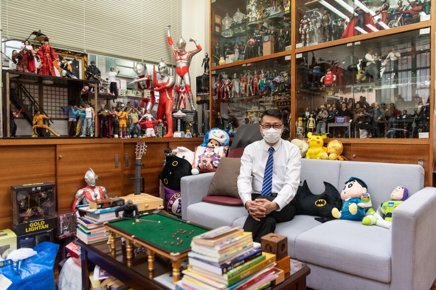 Lobo Ho, principal of Maryknoll Fathers' Secondary School, fills his office with toys and figurines so a visit to the principal won't be a negative experience.