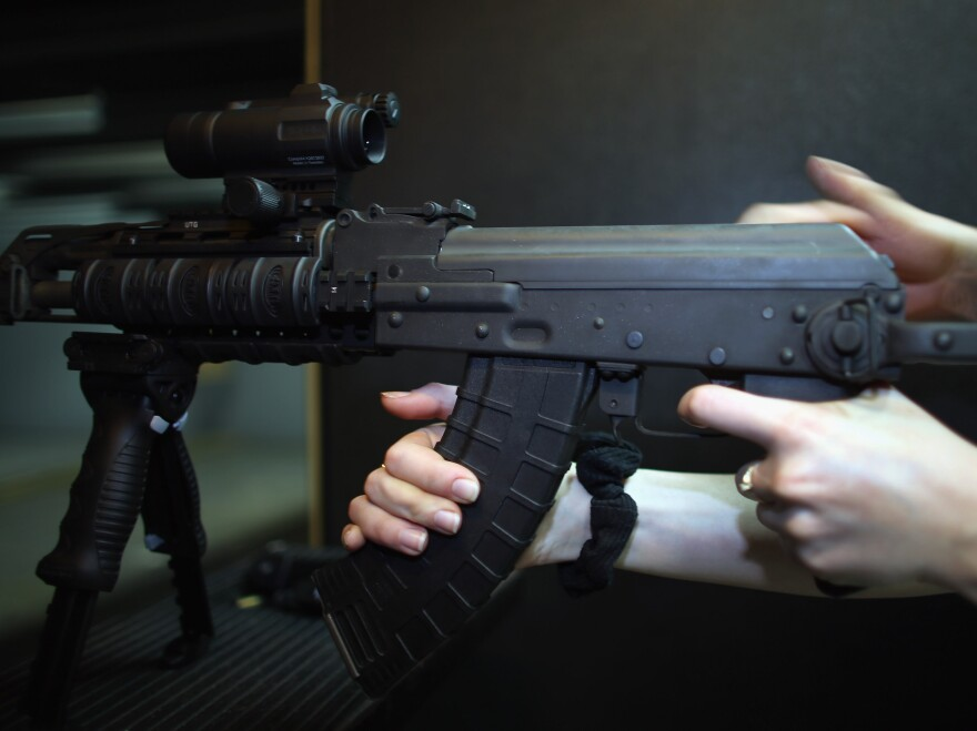 A weapon is used on the indoor firing range at the National Armory gun store in Pompano Beach, Fla., in April.