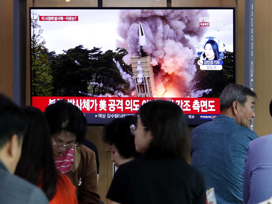People at the Seoul Railway Station watch a newscast showing a file image of a North Korean missile launch. North Korea on Wednesday fired projectiles toward its eastern sea, South Korea's military said, in an apparent display of its expanding military capabilities ahead of planned nuclear negotiations with the United States this weekend.