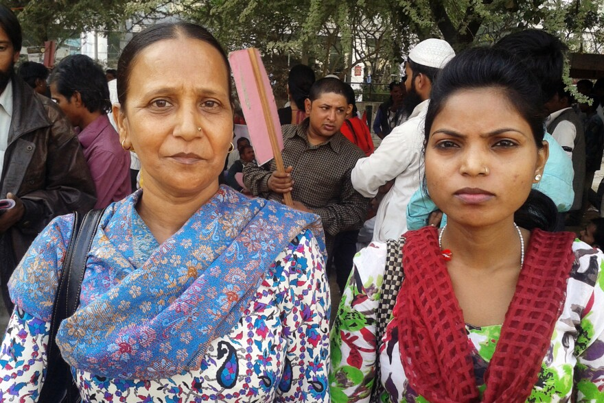 Sudha (left), a 42-year-old widow, sells purses at a market in West Delhi. Lately, she says, her business has suffered as more people opt to shop in malls.