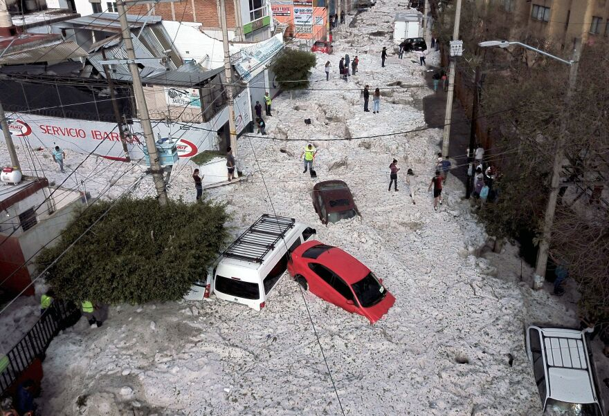 Vehicles were buried in hail on Sunday in eastern Guadalajara, Jalisco state, Mexico. The accumulation of hail buried vehicles and damaged homes.