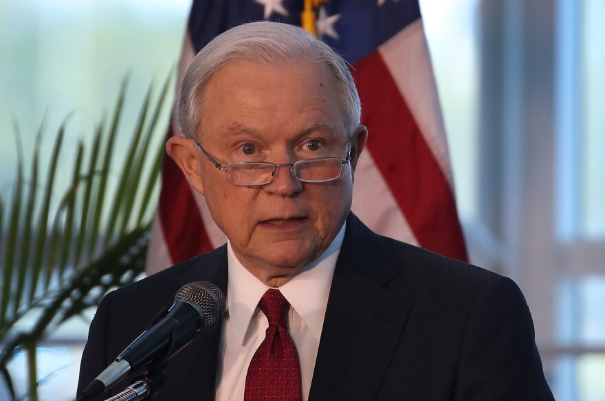 Attorney General Jeff Sessions, seen on Aug. 16, announced Monday that the administration would once again supply local law enforcement with military-style equipment, reversing an Obama-era restriction.