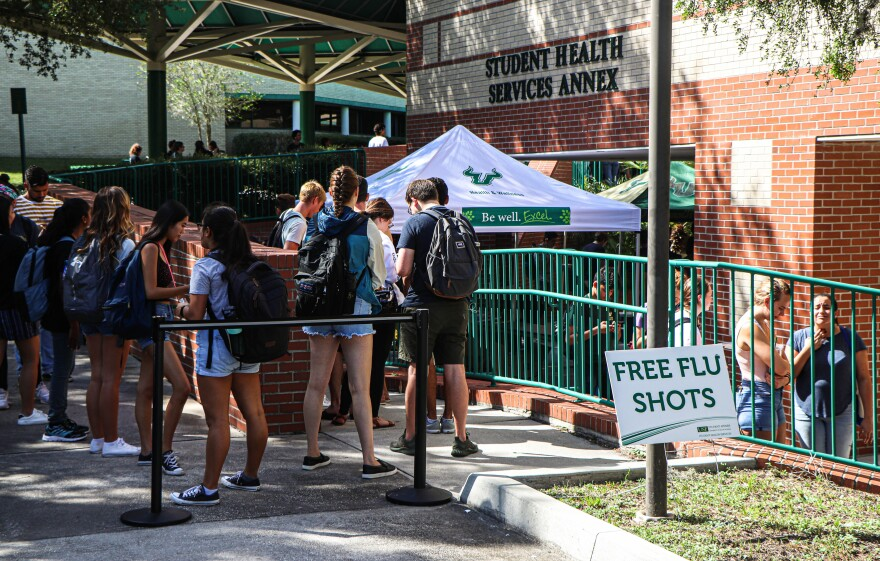 "Students lined up outside the Student Services Annex to recieve free flu shots as USF participated in the first ever ""4 U's Fight the Flu."" Thomas Iacobucci/WUSF Public Media"