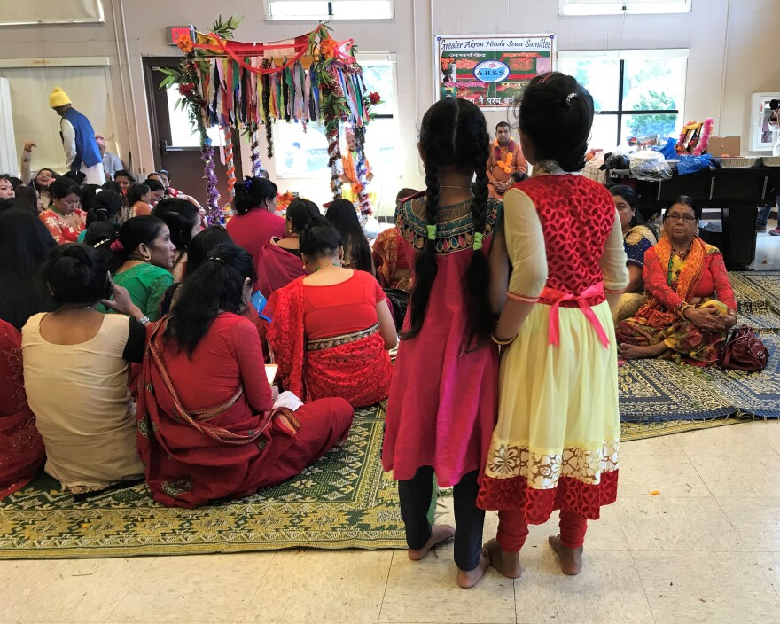 photo of girls watching celebration of Hindu festival of Teej