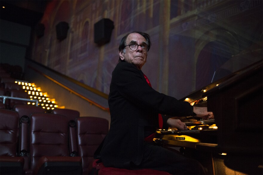 "Gerry Marian, who plays the organ at Chase Park Plaza Cinemas, looks at the screen while rehearsing. This weekend, Marian will perform an original live score during showings of ""The Phantom of the Opera."" Oct. 22, 2019"