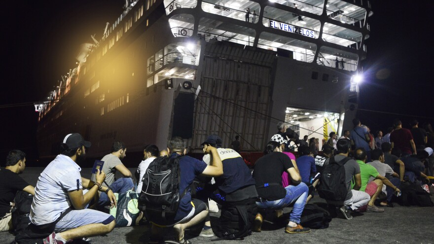 Syrian refugees prepare to board the passenger ship <em>Eleftherios Venizelos</em> at Kos's main port on Sunday in Kos, Greece. The vessel will house more than 2,500 refugees and migrants who entered the country from the Turkish coast.