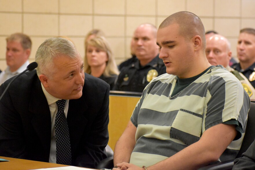 Collin Richards speaks with one of his attorneys at his sentencing hearing on August 23, 2019.