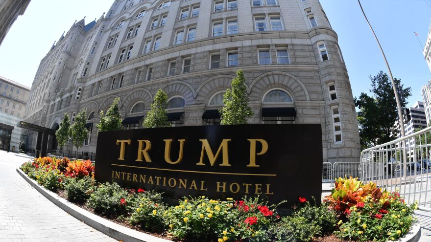 "A lawsuit against President Trump alleges he is violating the Foreign and Domestic Emoluments clauses of the Constitution. Plaintiffs' lawyer Deepak Gupta says Trump's Washington hotel (above) is ""an emoluments magnet."""