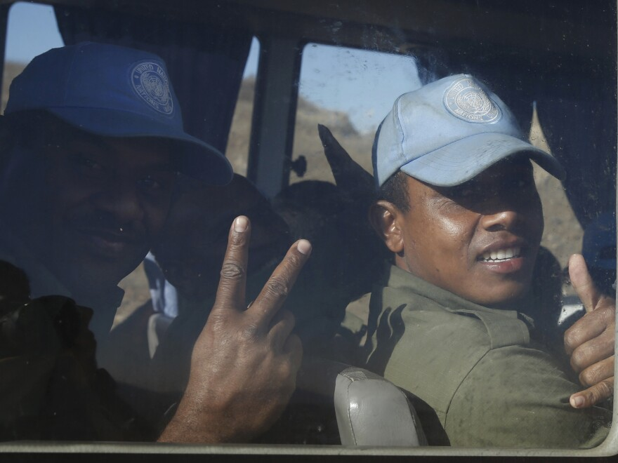 Fijian U.N. peacekeepers released by the group Nusra Front in Syria on Thursday as they arrive in Israeli-held territory on the Golan Heights.