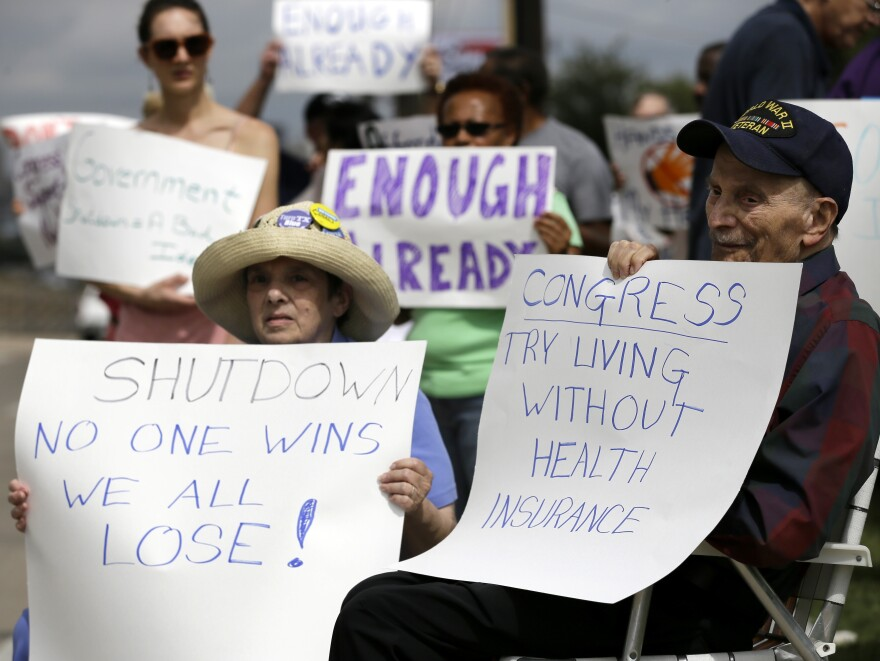 Susan and Jack Cooper of Richardson, Texas, demonstrate against the government shutdown in Dallas this month.
