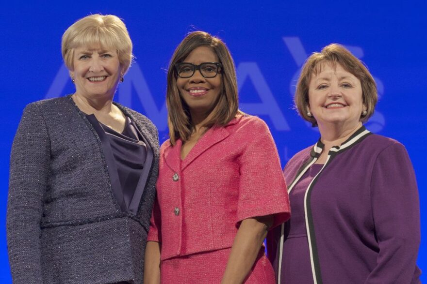 AMA President Dr. Patrice Harris (center) stands with the immediate past president Dr. Barbara McAneny (left) and president-elect Dr. Susan Bailey.