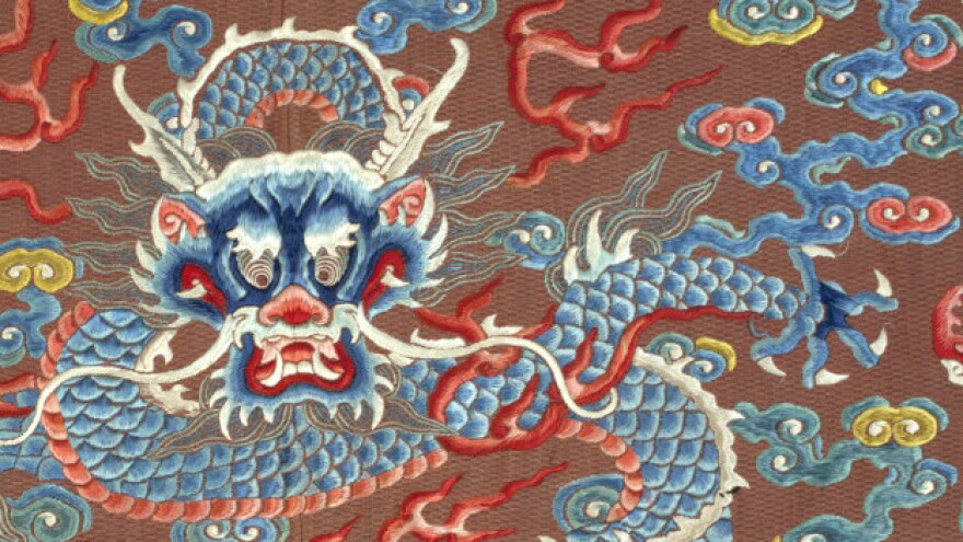 """A close-up of a dragon robe, or <em>long pao</em>, dated late 18th- or early 19th-century China. It's one of many on display in the exhibit """"Dragons, Nagas, and Creatures of the Deep"""" at the Textile Museum in Washington, D.C."""