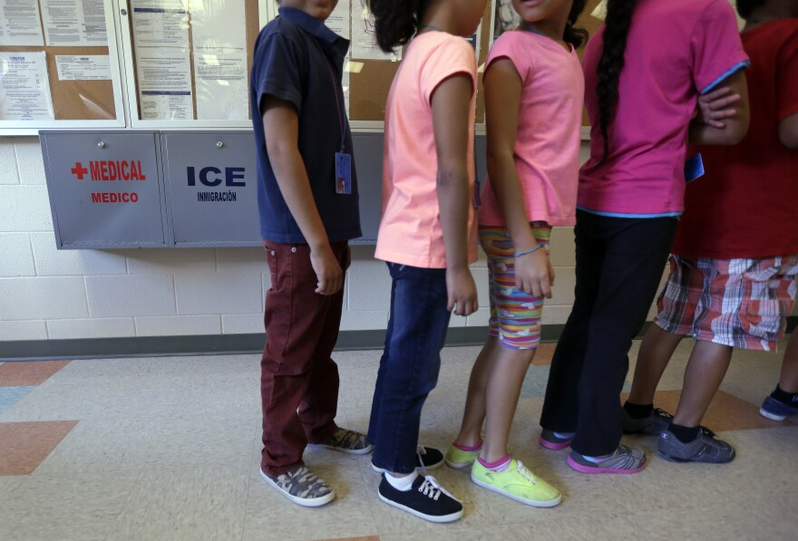 Detained immigrant children line up in the cafeteria at the Karnes County Residential Center, a temporary home for immigrant women and children detained at the border.