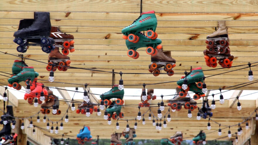 Roller skates and string lights hang from a wooden pagoda in the center of the roller rink in Philadelphia's Delaware River waterfront.