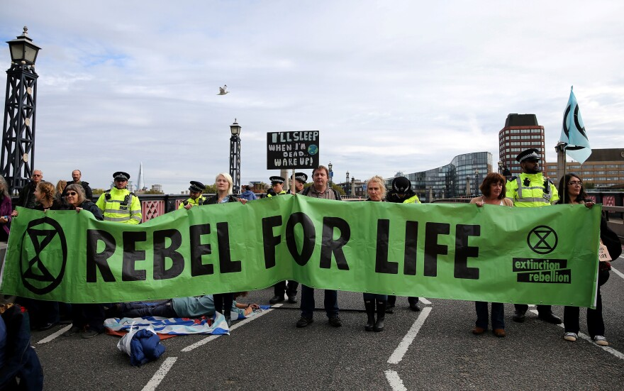 Climate change activists from the group Extinction Rebellion demonstrate on Lambeth Bridge in central London on Monday. The group has planned protests in Europe, North America and Australia over the next two weeks.