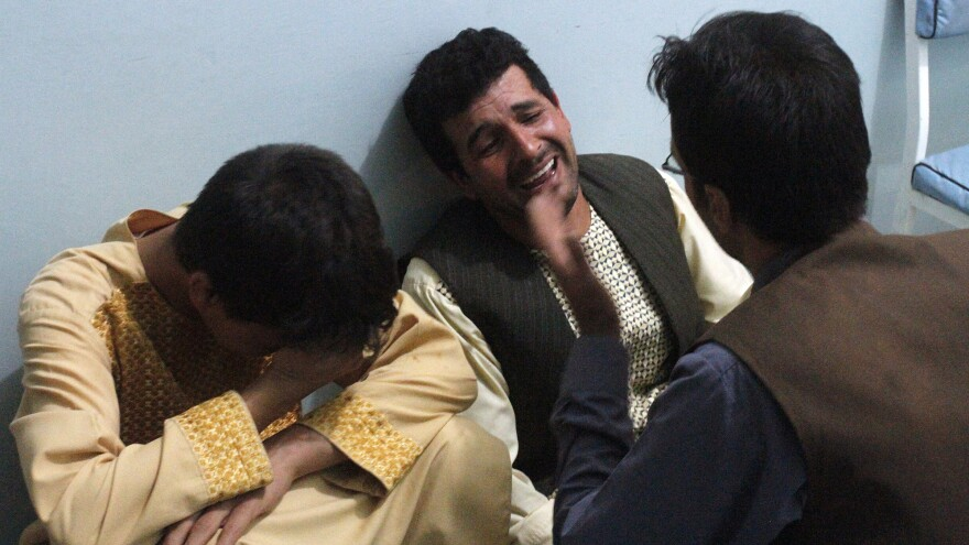 After a suicide attack on a Shiite mosque in Herat, relatives of the victims grieve for the loved ones they lost in the violence Tuesday.