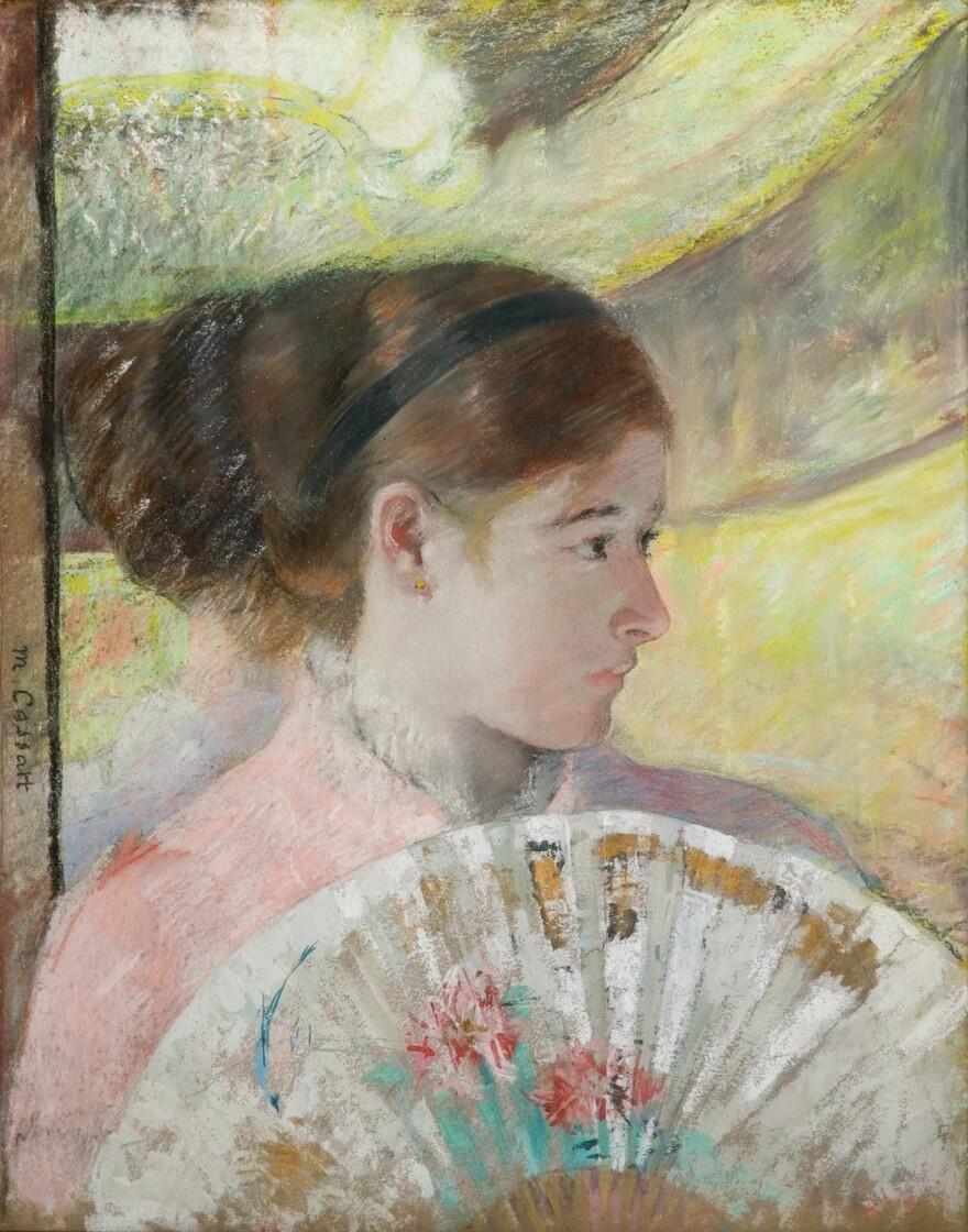 In her 1878-1879 work, <em>At the Theater</em>, Cassatt incorporates metallic paint with gouache and pastel.