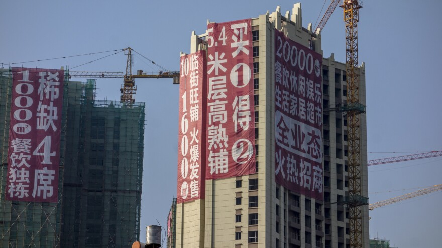 A sign promotes a real estate project last month in Kunming, China. Construction of residential and commercial properties has outpaced demand in China, a factor that some analysts cite in forecasting another global economic downturn.