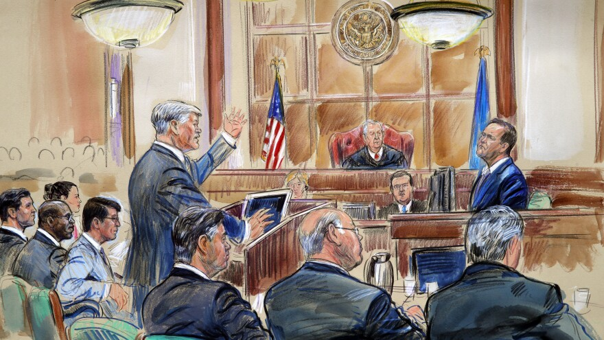 This courtroom sketch depicts defense lawyer Kevin Downing questioning of Rick Gates, as former Trump campaign chairman Paul Manafort (bottom front left) listens.