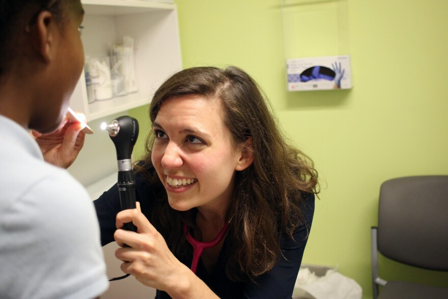 Public health experts suggest every doctor visit is an opportunity to vaccinate. Dr. Melanie Siefman examines an 11-year-old patient at a Unity Health Care clinic in Washington D.C. who came in for allergies, and ended up getting three vaccinations.