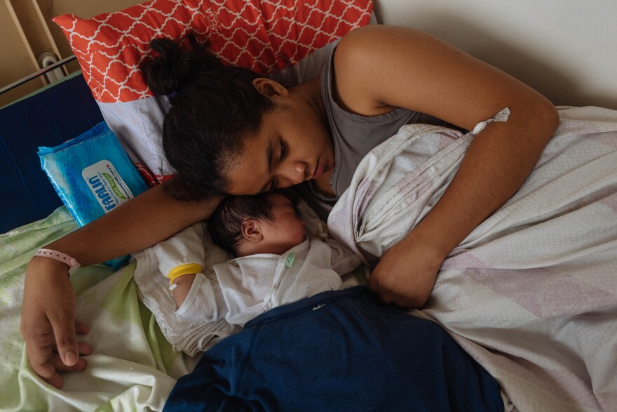 In November 2019, 18-year-old Ralyn Ramirez curls up with her second child, a boy. In between giving birth, she had warned other teens about having a baby.