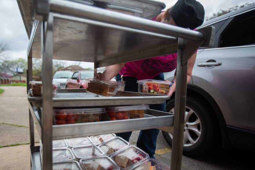 Austin ISD distributes meals to students at Josephine Houston Elementary in March.