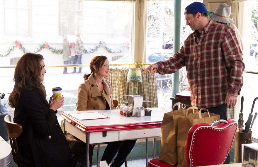 Lorelei and Rory Gilmore get a cup of joe at Luke's Diner in a scene from the show <em>Gilmore Girls. </em>Luke's — and coffee — were a very big part of the show.