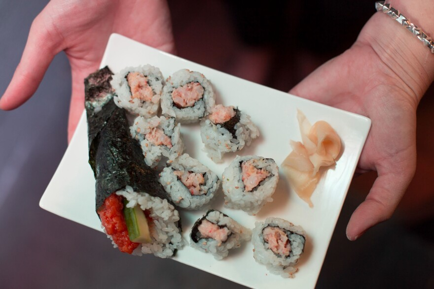 One of the delicious tricks we picked up at sushi school: how to make this spicy salmon cucumber and crunchy shrimp roll.