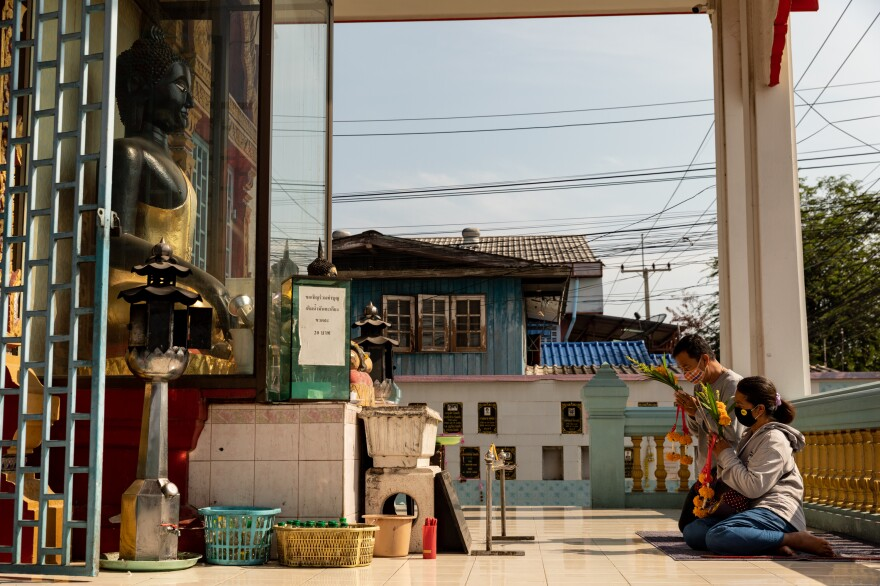 Passersby pray at the Thamniyom temple in Ayutthaya, a city an hour north of Bangkok.