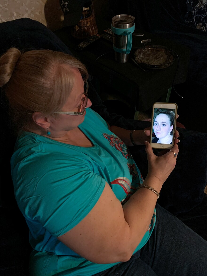 Cindy Moore holds an image of her daughter Kimberly Moore Angus, of Powhatan Point, Ohio. Angus, a mother of two, died of a drug overdose on Dec. 2, 2016.