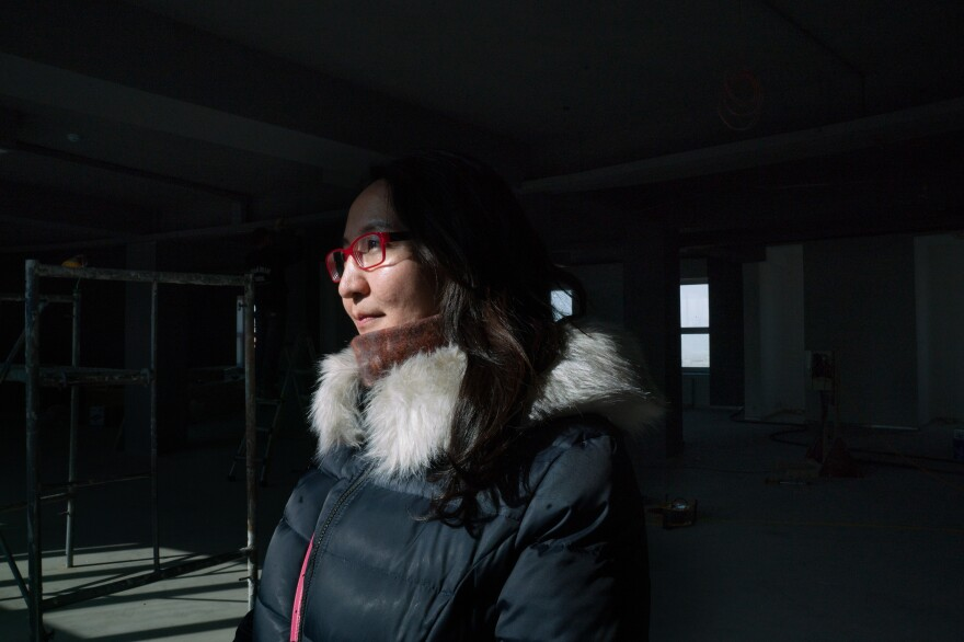 Boloroo Naranbaatar, 43, argues that air quality will improve when quality of life improves in the <em>ger</em> district. She is overseeing a government-led project to expand infrastructure and central services in the most polluted neighborhoods.