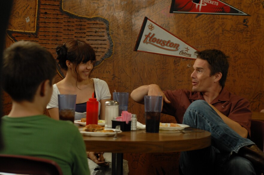 In <em>Boyhood</em>, Ethan Hawke (right) plays the divorced father of Mason (Ellar Coltrane) and Samantha (Lorelei Linklater). Hawke says he'd love to see his character get older.