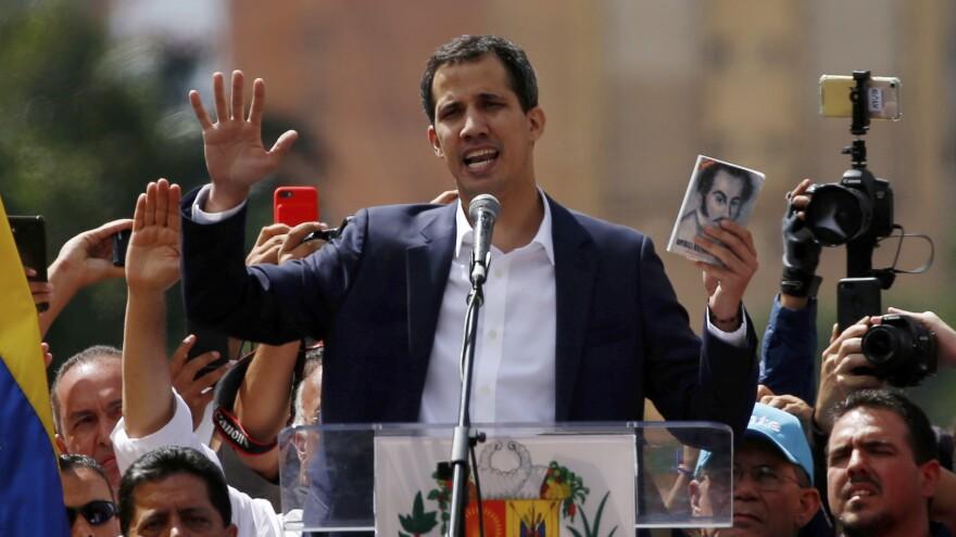Juan Guaidó, head of Venezuela's opposition-run congress, declares himself interim president of Venezuela during a rally against President Nicolás Maduro in the capital, Caracas, on Wednesday.