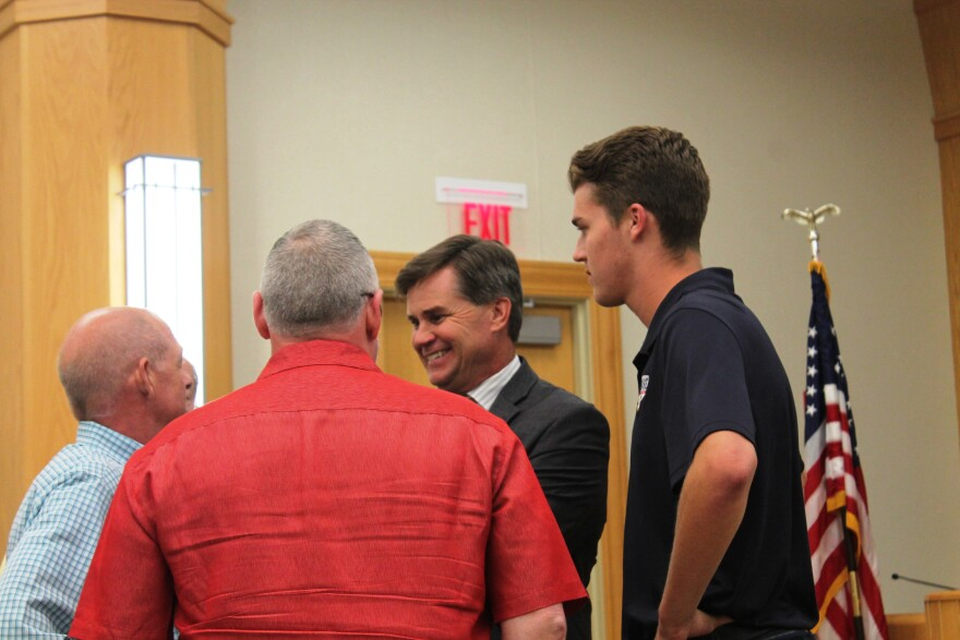 Dan Buck, center, and his son Quinn, right, talk to supporters of Buck's POWERplex development on Monday, June 5, 2017, after Chesterfield officials announced the deal to build the $55 million facility was dead.