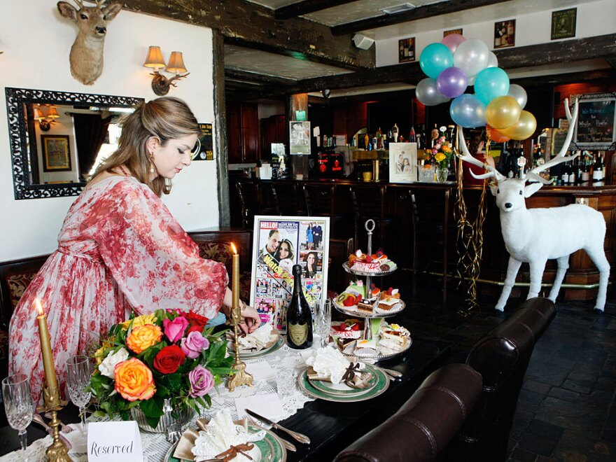 Golriz Moeini decorates her White Harte Pub with items she plans to use for a royal wedding watch party in Woodland Hills, Calif.