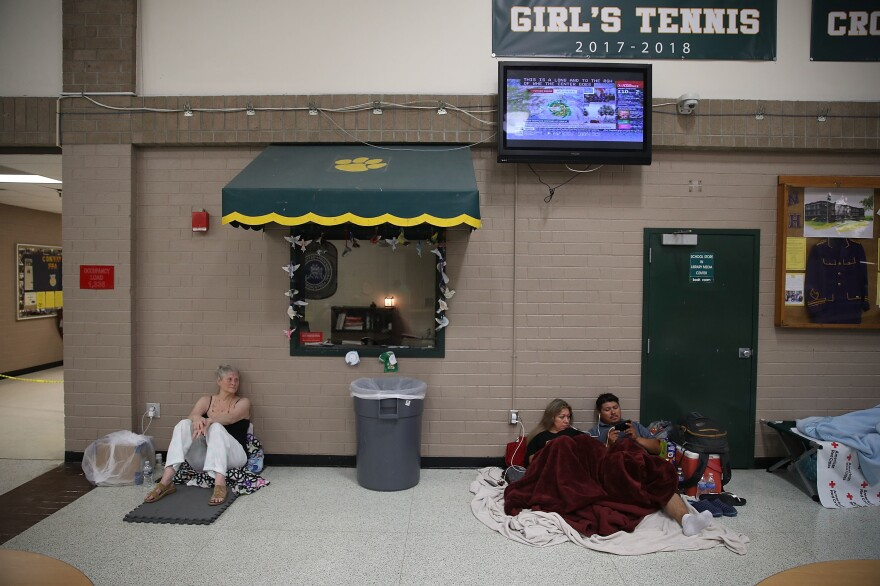 Evacuees wait for the arrival of 2018's Hurricane Florence inside a North Carolina school shelter. Many coastal states have long-standing shelter shortages. That's being exacerbated this year by recommendations from the American Red Cross and the Centers for Disease Control and Prevention to give evacuees up to three times more personal space to allow for social distancing.