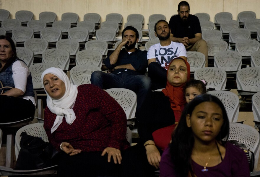 Family and friends watch the CaiRollers from the stands. While families are usually supportive, they have concerns about the women playing such an aggressive game, says Lina El-Gohary.