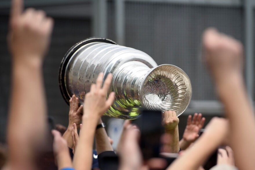 The Stanley Cup passes through the hands of fans toward the end of the Blues victory parade. June 15, 2019