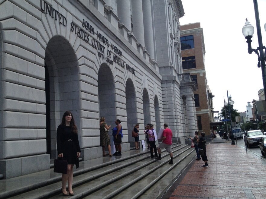 Supporters and opponents of Texas's controversial abortion law gathered Friday afternoon outside the 5th Circuit Court of Appeals in downtown New Orleans. Emily Horne (left) is a legislative associate with Texas Right to Life, a group that lobbied for the law.