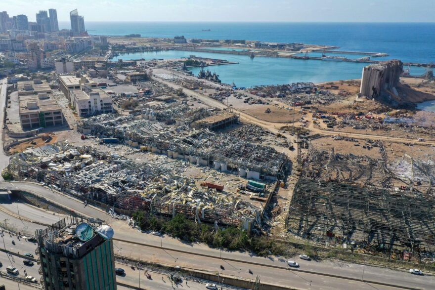 An aerial view shows the massive damage done to Beirut port's grain silos (C) and the area around it after a mega-blast tore through the harbor in the heart of the Lebanese capital with the force of an earthquake, killing more than 100 people and injuring over 4,000.