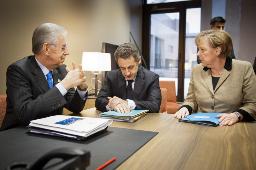 In this photo provided by the German Government Press Office, Italy's Prime Minister Mario Monti, France's President Nicolas Sarkozy and Germany's Chancellor Angela Merkel speak at a meeting at the European Council in Brussels ahead of the European Union leaders summit on Monday.