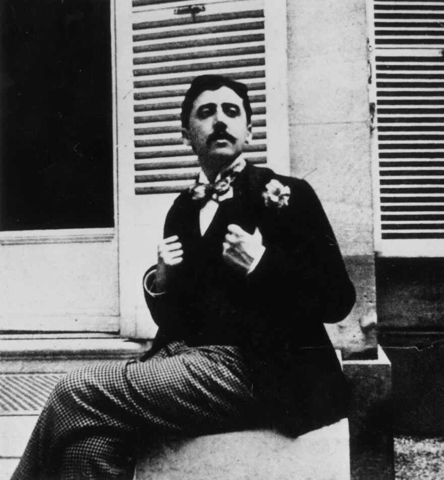 In this photograph, taken circa 1910, Marcel Proust poses outside a window. The image places Proust roughly a few years before the publication of the first volume of his masterpiece, <em>In Search of Lost Time</em>.