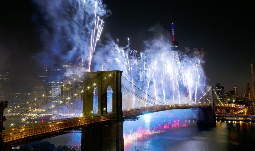 Fireworks light up the sky above the Brooklyn Bridge during Macy's 4th of July Fireworks Spectacular in 2014.