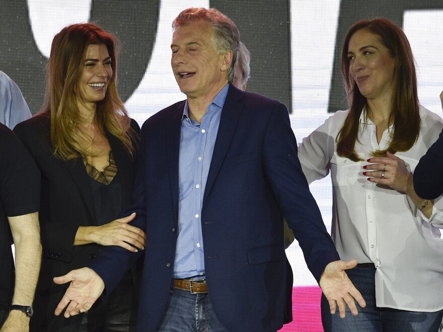 Macri, who was running for reelection, is greeted by his wife, Juliana Awada (left) and the governor of Buenos Aires province, María Eugenia Vidal, after conceding the election before supporters in Buenos Aires.