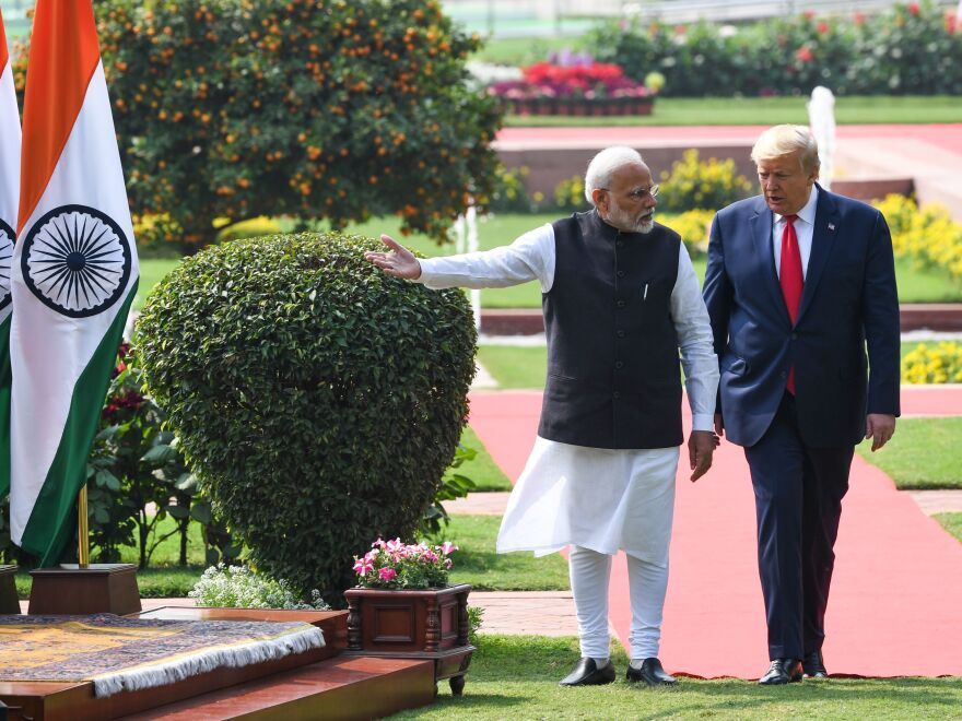 President Trump and India's Prime Minister Narendra Modi arrive for a joint press conference in New Delhi on Tuesday.